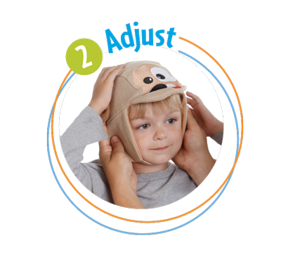Place the Ouchie Cap on your little one. title=Place the Ouchie Cap on your little one.  The strap fits nice and comfy around the chin to hold the hot and cold packs in place so you or your child doesn't have to!